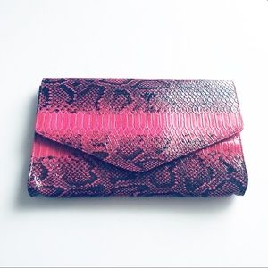 Diane Goes Hollywood Pink faux snakeskin clutch